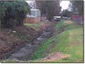 Image of drainage ditch after being cleared by the XL 330