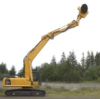 an HD 480B mounted on an excavator reaching up high and tilting toward the camera