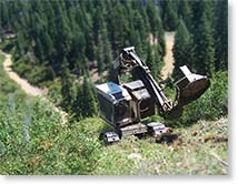 timbco self leveling cab with slashbuster brush cutter clearing brush on a steep slope